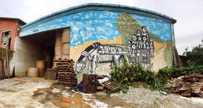 Pupo Bibito performes on farm wall