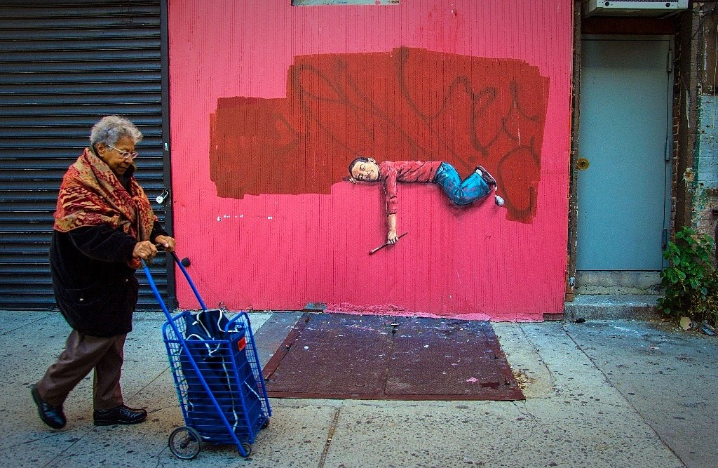 Boy on a fence, Corner of 107th St and Lexington East Harlem