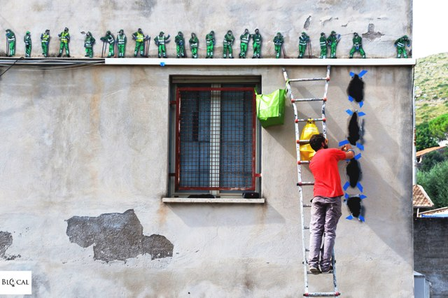 Jaune paints characters at Gaeta's Waste Collection Centre
