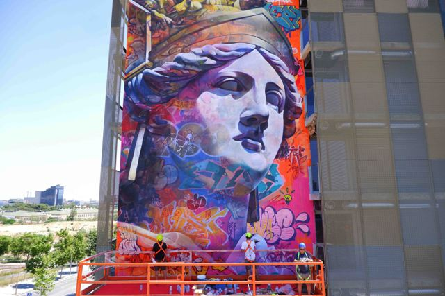 PichiAvo paint a 125m2 mural of Athena in Barcelona