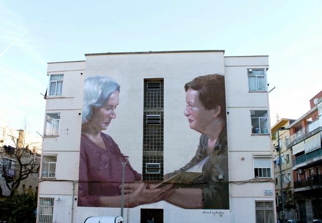 Elisa Capdevila paints community mural in Barcelona