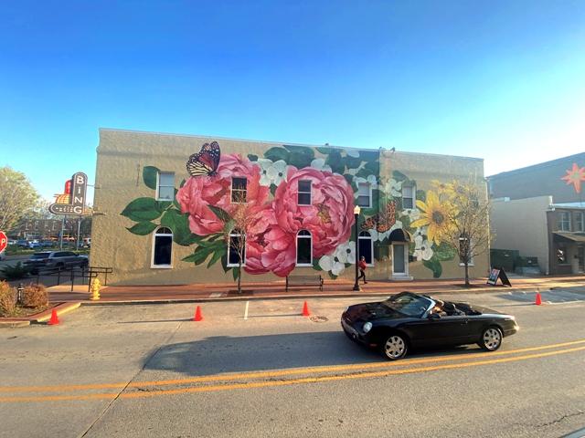 Artist Ouizi Creates Blooming Artwork In Bentonville